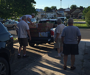 Volunteers Loading Food Donations into a truck